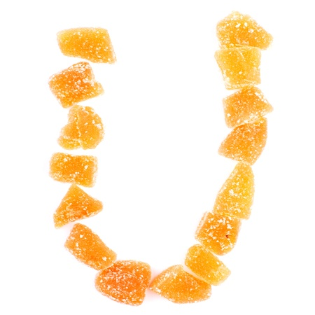 letter U written with slices of dried sweet fruits photo