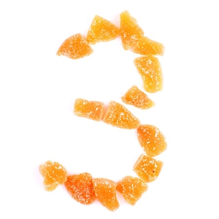 number 3 written with slices of dried sweet fruits photo