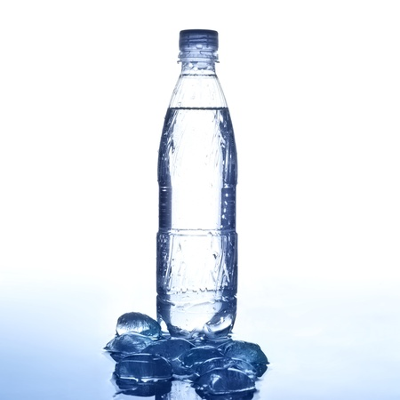 bottle of fresh cold water and ice cubes       photo