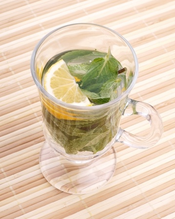 glass fresh water with mint and lemon on a bamboo table Stock Photo - 19323833