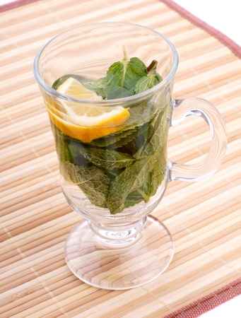 glass fresh water with mint and lemon on a bamboo table Stock Photo - 19330029