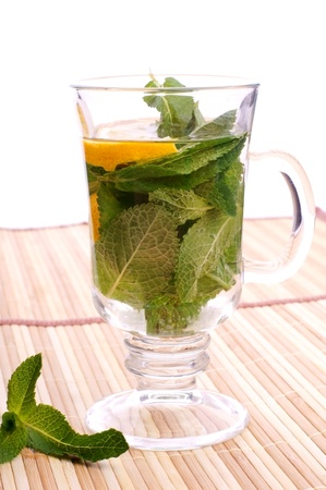 glass fresh water with mint and lemon on a bamboo table Stock Photo - 19330027