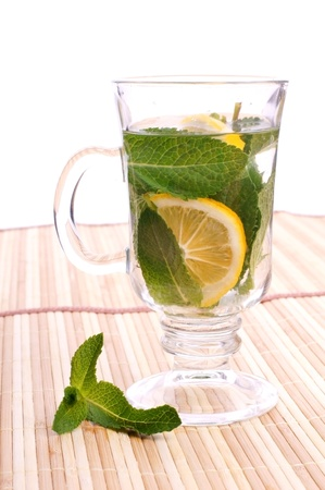 glass fresh water with mint and lemon on a bamboo table Stock Photo - 19330026