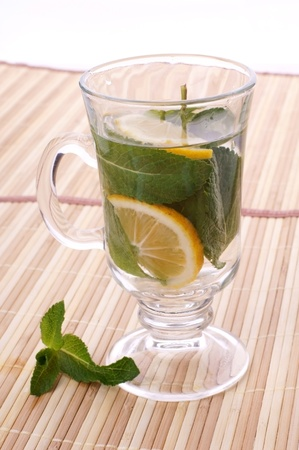 glass fresh water with mint and lemon on a bamboo table Stock Photo - 19330025