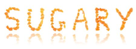 sugary: word sugary with reflection written with letters of sugary dried fruits Stock Photo