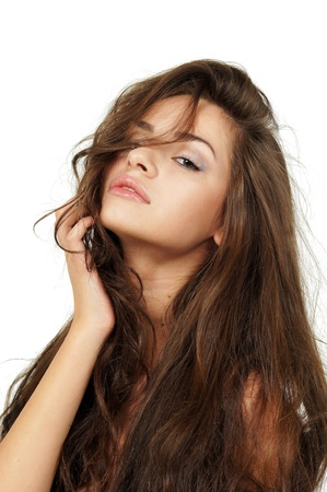 beautiful brunette: stodio portrait of young beautiful brunette woman against white background Stock Photo