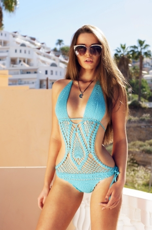 blue lingerie: beautiful sexy girl posing in blue swimsuit outdoors
