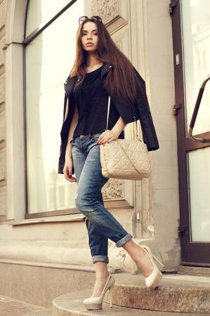 young beautiful stylish girl with handbag           스톡 콘텐츠