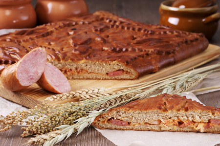 satisfying: Traditional russian pie with sausages and cheese