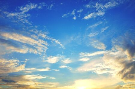 blue sky with few clouds at sunset lights Stock Photo