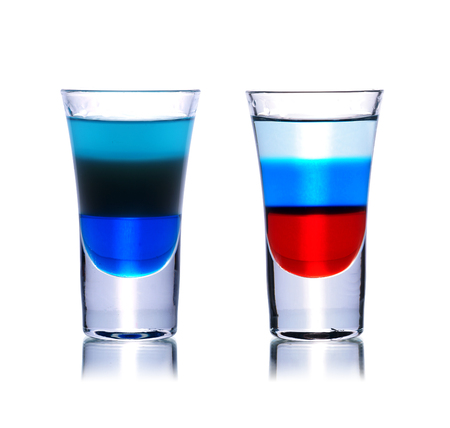 shooters: Set of colorful alcoholic cocktails in shot glasses isolated on white with reflection. Colletion of shooters Stock Photo