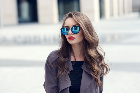 gray hairs: Outdoor closeup fashion style portrait of young pretty stylish girl with long curly hair wearing sunglasses