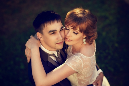 Closeup portrait of young beautiful just married couple hugging from upper point of view