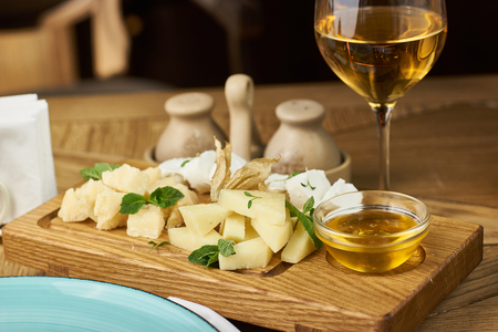 Cheese plate with honey and wine