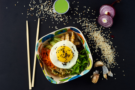 Bibimbap. Mixed rice with meat and vegetables.