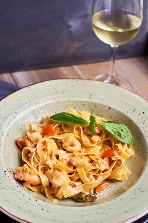 Tagliatelle with prawns and spices in tomato-cream sauce Stock Photo