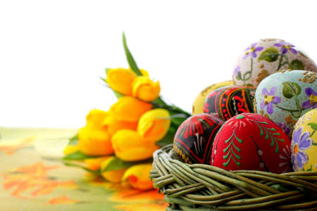 Beautiful basket with Easter eggs photo