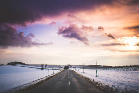 long road: Long Road with Colorful Sunset Stock Photo
