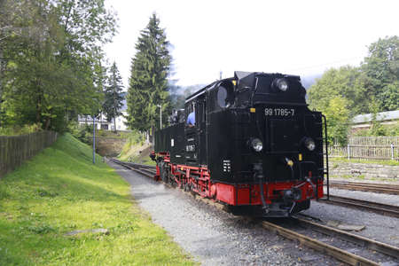 brocken: BROCKEN MOUNTAIN, SAXONY-ANHALT GERMANY May 26 2012: historical locomotive is going up high to Brocken Peak with tourists. Brocken is part of Harz National Park.