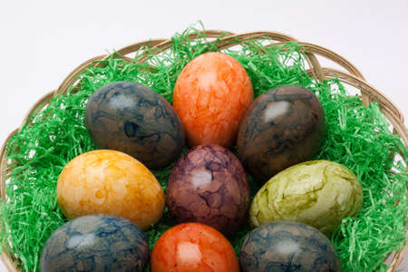 coloration: Traditional coloration eggs with slate or onion skin. Pot, easter eggs, onion skin at wooden background.