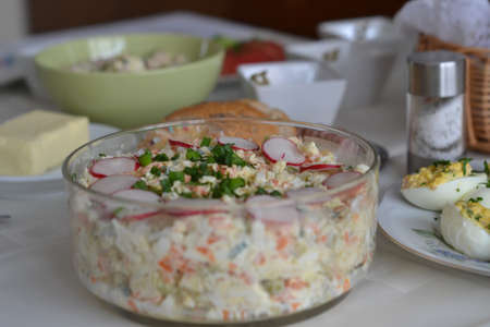 A fresh and light salad with egg and cheese photo