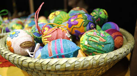 Easter eggs in the basket of wooden boards photo