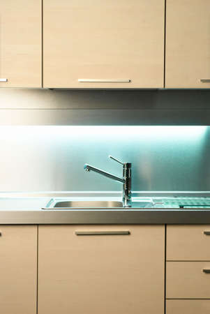 hot water tap: Modern stainless steel tap in white kitchen