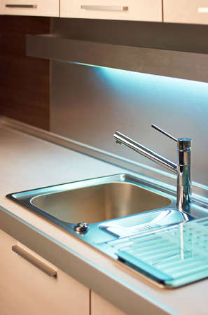 kitchensink: Modern stainless steel tap in white kitchen