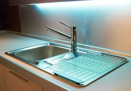 basin: Modern stainless steel tap in white kitchen