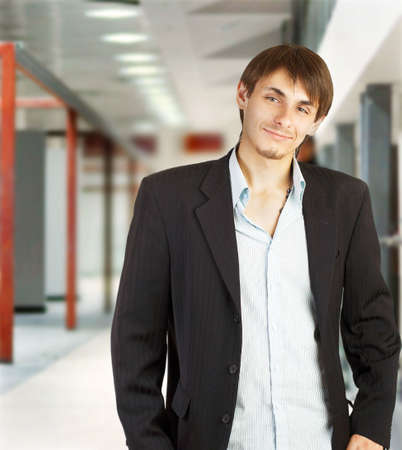 Young businessman walking in a corridor of a modern office building Stock Photo