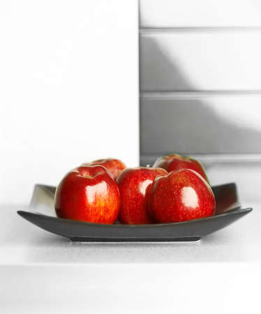 Granny smith apples on table in modern kitchen photo