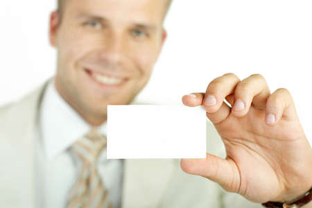 smartness: Businessman holding visit card isolated on white.