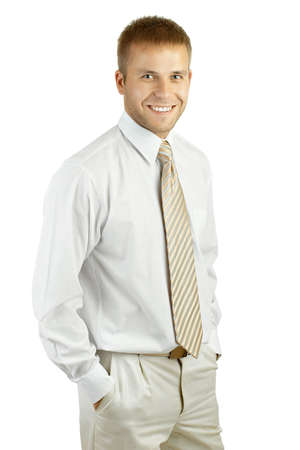 Portrait of a young laughing businessman standing against isolated white background photo