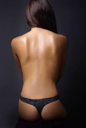 Classic low-key photo of sexy woman back, isolated on black background Stock Photo - 4307572