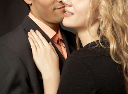Beatiful couple in love on black background Stock Photo - 4335512