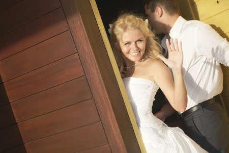 bye: Lovely bride saying good bye near door after wedding. Warm summer day, wedding at tropical caribbean island or Hawaii.