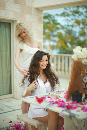 day dream: Gorgeous, lovely bride, model with young friend preparing to wedding day. Dream wedding with lot of flowers, shiny and ethereal.