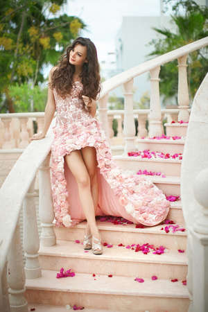 flawless: Dream wedding, beautiful bride, walking down stairs in flawless dress with flowers behind.