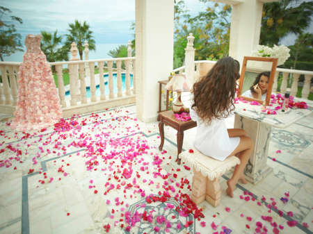 day dream: Gorgeous, lovely bride, model preparing to wedding day. Dream wedding with lot of flowers, shiny and ethereal. Stock Photo