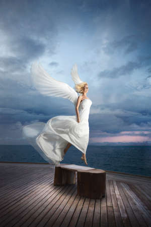 Ethereal, divine, unreal bride lfly like a bird from ocean pier. Outstanding, magnificent retouch.