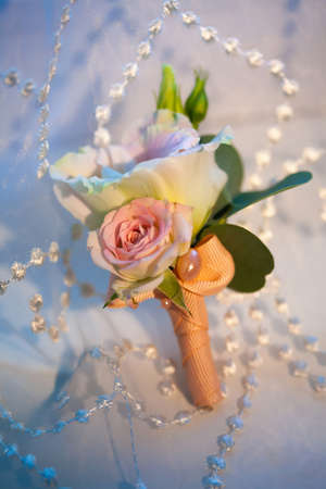 boutonniere: Mens Wedding boutonniere on a blue background Stock Photo