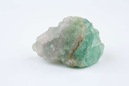 octahedral: Green fluorite. Mineral natural stone on a white background. Stock Photo