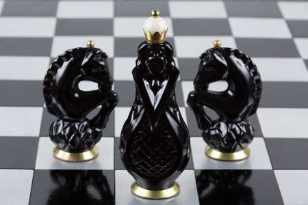 pawns: Glass chess pieces on a metal chessboard