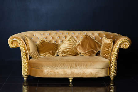 Luxury Golden Sofa On A Black Background Stock Photo, Picture And Royalty  Free Image. Image 71626417.