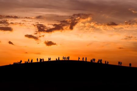 crowd of happy people: Group of people enjoying the sunset on hill Stock Photo