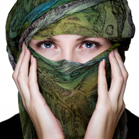 eyes hidden: Woman with veil over white backgroung