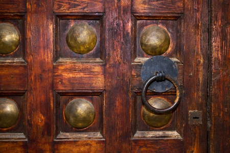 An old door with circle iron door-handle photo