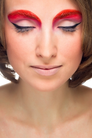 Portrait of beautiful woman with fashion makeup photo