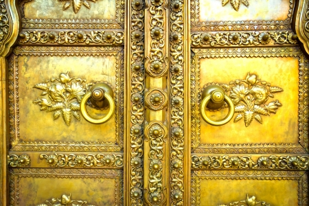 Golden door in City Palace Jaipur, India photo