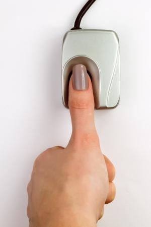 biometric: Finger on a biometric fingerprint device  Stock Photo